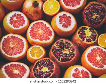 Flatlay view of orange, pomegranate, lemon, grapefruit filtered image