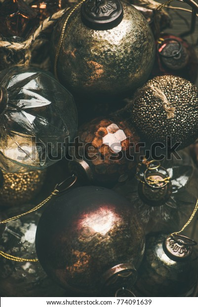 Flat-lay of vintage Christmas or New Year holiday tree decoration balls, top view. Holiday greeting card background, vertical composition