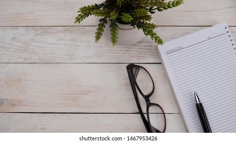 Flatlay workspace,note book on white wooden background, banner concept