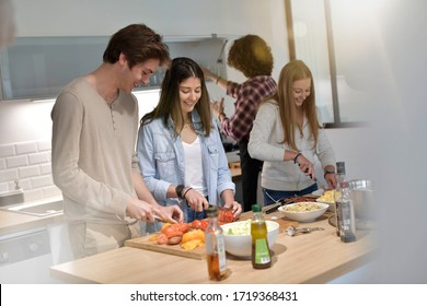 Flatmates cooking together at home