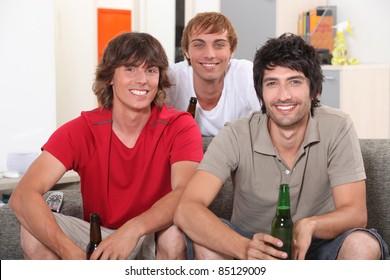 Flatmates enjoying a beer together