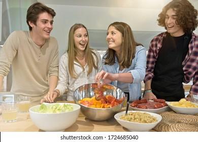 Flatmates enjoying cooking together at home
