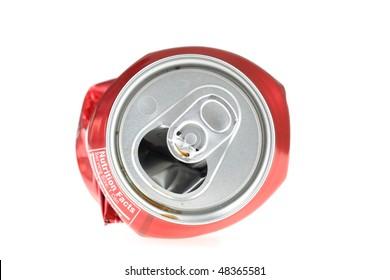 Flattened soda can.
