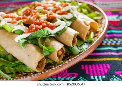 flautas de pollo, chicken tacos and Salsa Mexican food mexico city