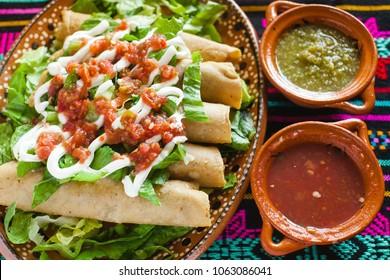 flautas de pollo tacos and Salsa Homemade Mexican food mexico city