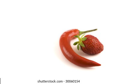 Flavor contrasts:. a Jalapeño red hot chilly, gently surrounding a sweet strawberry