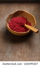 Flavor dry sumac in bowl, spice close-up