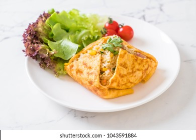 Flavored Fried Rice in an Omelet Wrapping with vegetable