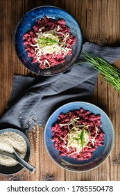 Flavorful boiled beetroot dumplings topped with hummus, smoked tofu and chives