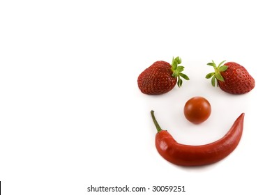 Flavour contrasts:. a smiling face made of Jalape���±o red hot chillies, mini tomatoes and strawberries
