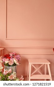 Flawers in the vase in pink classic style interior opposite wall