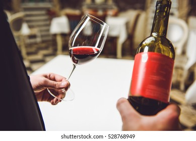 Flawless scarlet wine in fragile goblet