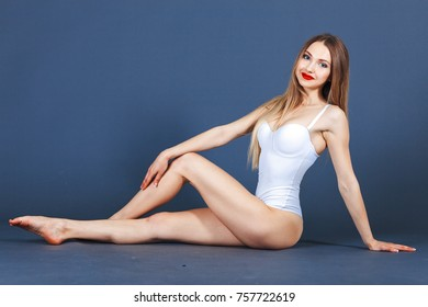 Flawless woman on blue background. Photo of girl with red lips. Beauty and body care concept