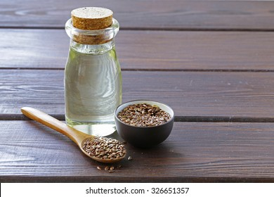 flax seed oil in glass bottle on a wooden table