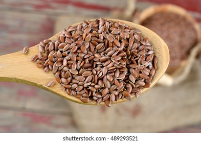 flax seed in wooden spoon
