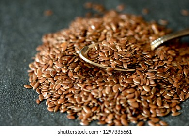 flax seed in wooden spoon , super food with hight of fiber nutrient and anti inflammatory omega-3 fatty acids