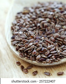 Flax seeds in a bowl close up