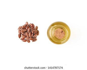 Flax seeds and flaxseeds oil. Isolated on white. Copy space for text. Top view or flat lay.