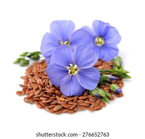 Flax seeds with flowers close up on white