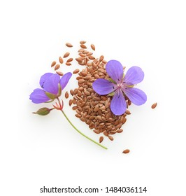 Flax seeds with flowers isolated on white background. Top view.