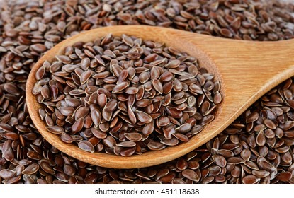 Flax seeds heap in wood spoon