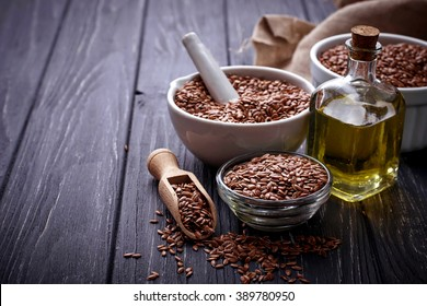 Flax seeds and linseed oil. Selective focus