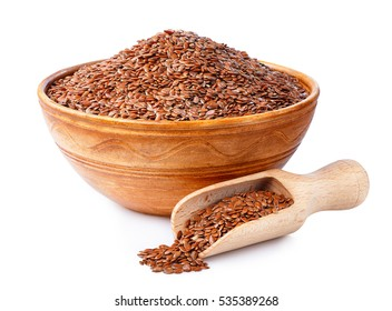 Flax seeds or linseed in wooden scoop and in clay bowl isolated on white background