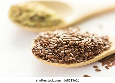 Flax seeds on painted wood board.