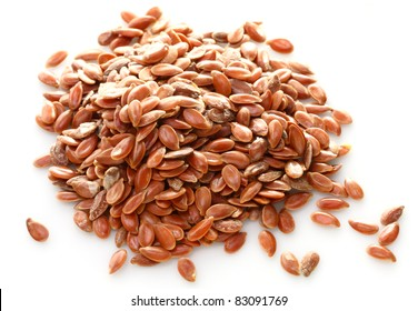 Flax seeds on white background. Close up with shallow DOF.