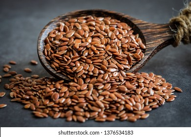 Flax seeds on wooden spoon