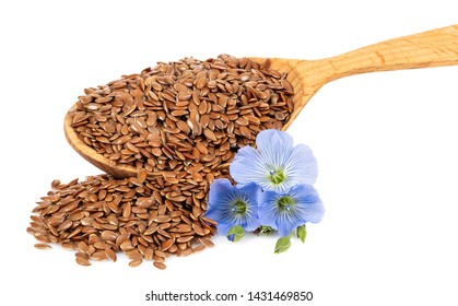 flax seeds in spoon and blue flowers isolated on white background