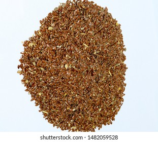 Flax seeds. Storage of flax seeds. Flax, essential oil culture. A handful of flax seeds