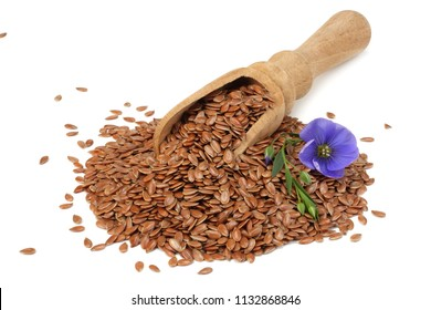 flax seeds in wooden spoon with flower isolated on white background. flaxseed or linseed. Cereals