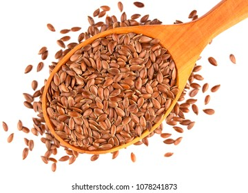 Flax seeds in wooden spoon isolated on white background.  Also known as Linseed, Flaxseed and Common Flax. Pile of grains, isolated white background.