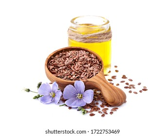 Flax seeds in wooden spoon with oil on white background.