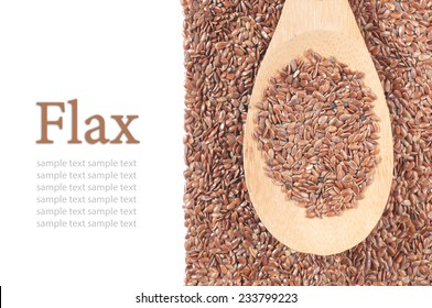 flax seeds with a wooden spoon on white background.