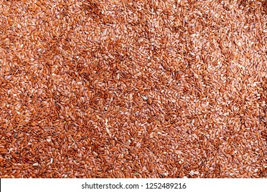 Flaxseed background. A background of dried flaxseeds.