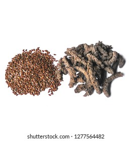 Flaxseed beside expellers after of the manufacture of flaxseed table oil in a extruder machine for a agro business showing the subproduct of the process used in animal feed