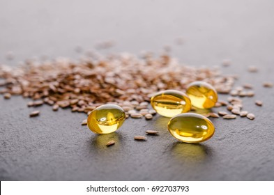 Flaxseed oil in caps on a grey background. Phytotherapy.