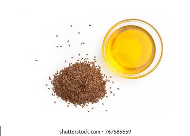 Flaxseed oil and pile of organic flax seed isolated on white background. top view
