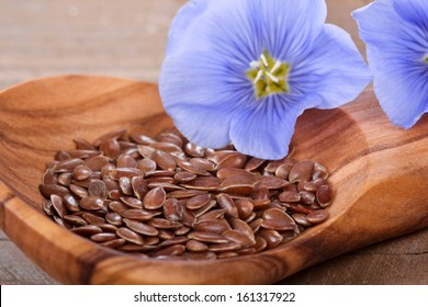Flaxseed on a wood spoon