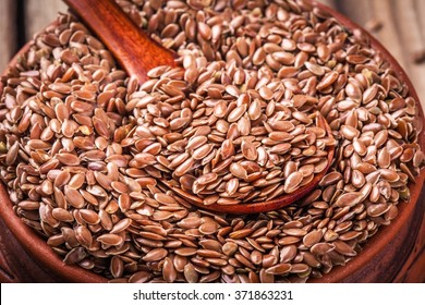 flaxseeds in bowl closeup. rustic style