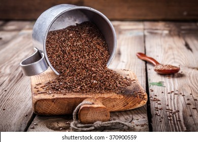 flaxseeds in bowl on a wooden table. rustic style