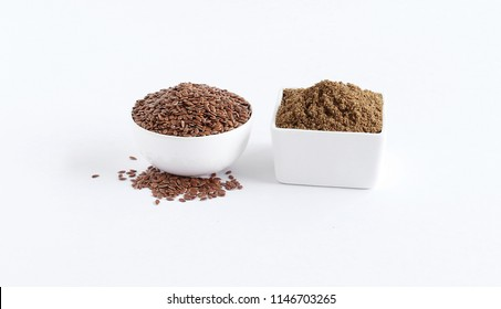 Flaxseeds and their powder, which are healthy food and contains, among others, omega-3 fatty acids and lignans, in bowls.