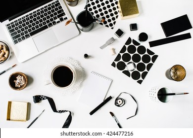 flay lay composition for bloggers, artists, magazines and social media. freelancer black style workspace with laptop, black coffee, sketchbook, napkins, ribbons, paintbrushes on white background.