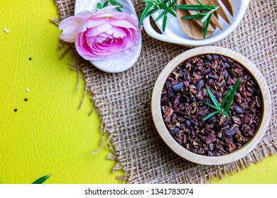 Flay lay composition space on Superfood crunchy cacao decorate with green rosemary leafs for better health lifestyle concept