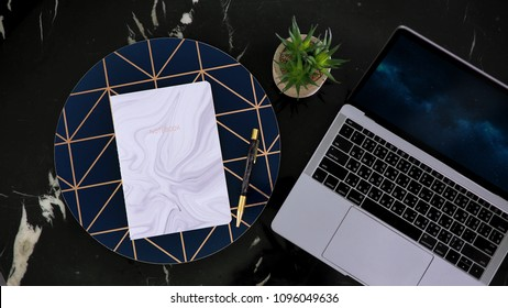 Flay lay, Top view office table desk. . Workspace with notebook, diary, pen, cactus on marble background.