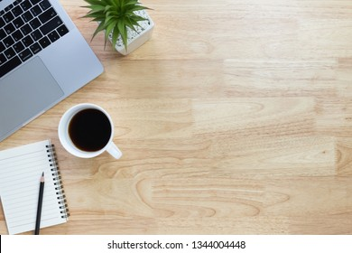 Flay lay, Top view office table desk with laptop, keyboard, coffee, pencil, notebook,  leaves with copy space background.