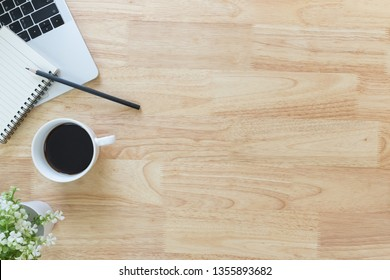 Flay lay, Top view office table desk with smartphone, keyboard, coffee, pencil, leaves with copy space background.