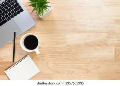 Flay lay, Top view office table desk with laptop, keyboard, coffee, pencil, leaves with copy space background.